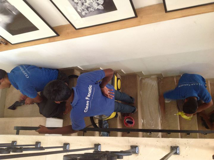Clean Fanatic team busy cleaning staircase carpet